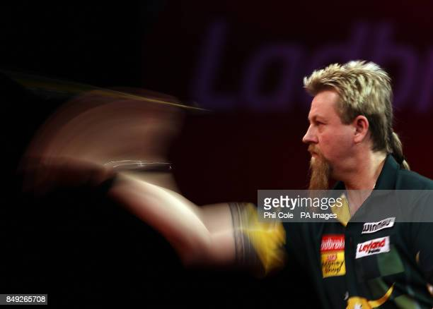 Simon Whitlock on his way to beating Dave Chisnall during the Ladbrokescom World Darts Championship at Alexandra Palace London