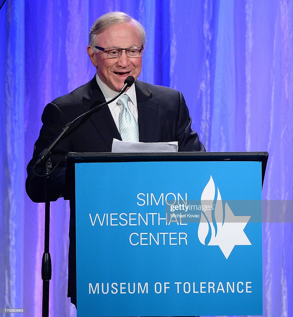 Simon Wiesenthal Center Chairman ofthe Board of Trustees Larry Mizel presents onstage at the Simon Wiesenthal Center National Tribute Dinner at Regent Beverly Wilshire Hotel on June 11, 2013 in Beverly Hills, California.