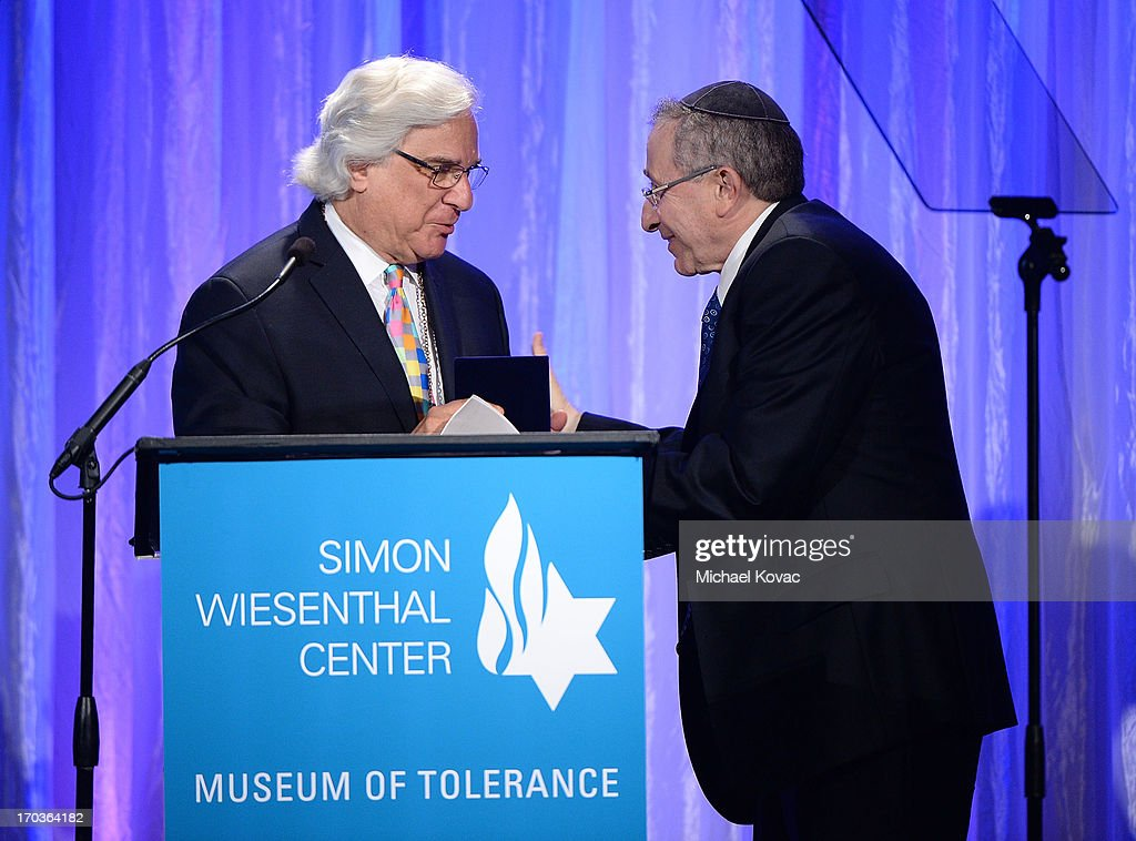 Simon Wiesenthal Center Founder Rabbi Marvin Hier (R) presents the Medal of Valor to Murry Sidlin at the Simon Wiesenthal Center National Tribute Dinner at Regent Beverly Wilshire Hotel on June 11, 2013 in Beverly Hills, California.