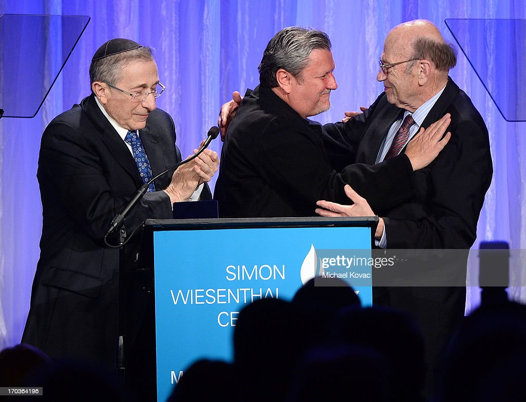 Simon Wiesenthal Center Founder Rabbi Marvin Hier (L) presents the Medal of Valor to Artemis Joukowsky III (C) accompanied by Dr. Alex Strasser at the Simon Wiesenthal Center National Tribute Dinner at Regent Beverly Wilshire Hotel on June 11, 2013 in Beverly Hills, California.