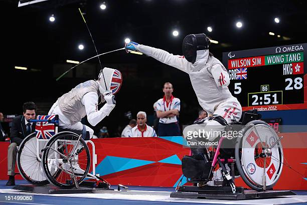 Simon Wilson of Great Britain competes against Tang Tat Wong of Hong Kong China during the Men's Team Catagory Open Wheelchair Fencing quarterfinal...