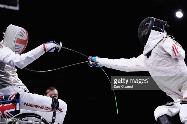 Simon Wilson of Great Britain competes against Tang Tat Wong of Hong Kong China during the Men's Team Catagory Open Wheelchair Fencing match on day...