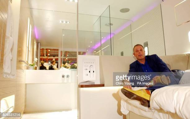 Simon Woodroffe founder of YO Sushi relaxes in his latest concept YOTEL at the '100% Design 2004' exhibition at London's Earl's Court The 105 sq...
