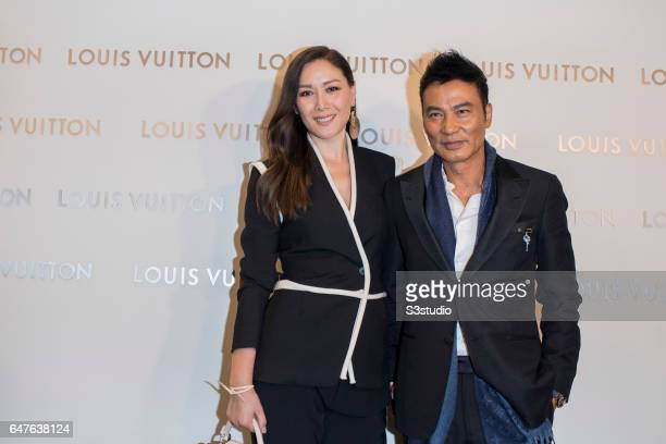 Simon Yam and his wife Sophia Kao known as 'Qi Qi' poses at the red carpet during the Louis Vuitton Landmark Maison opening on 02 March 2017 in...