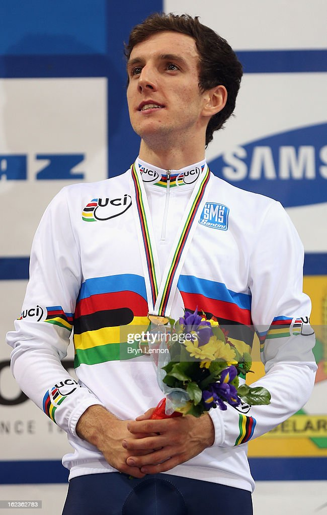 <a gi-track='captionPersonalityLinkClicked' href=/galleries/search?phrase=Simon+Yates+-+Cyclist&family=editorial&specificpeople=13316516 ng-click='$event.stopPropagation()'>Simon Yates</a> of Great Britain stands on the podium after winning the Men's Points Race on day three of the 2013 UCI Track World Championships at the Minsk Arena on February 22, 2013 in Minsk, Belarus.