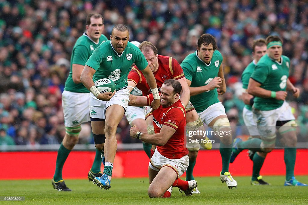 <a gi-track='captionPersonalityLinkClicked' href=/galleries/search?phrase=Simon+Zebo&family=editorial&specificpeople=7036694 ng-click='$event.stopPropagation()'>Simon Zebo</a> of Ireland breaks through the tackles from <a gi-track='captionPersonalityLinkClicked' href=/galleries/search?phrase=Jamie+Roberts&family=editorial&specificpeople=3530992 ng-click='$event.stopPropagation()'>Jamie Roberts</a> and Alun Wyn Jones of Wales during the RBS Six Nations match between Ireland and Wales at the Aviva Stadium on February 7, 2016 in Dublin, Ireland.