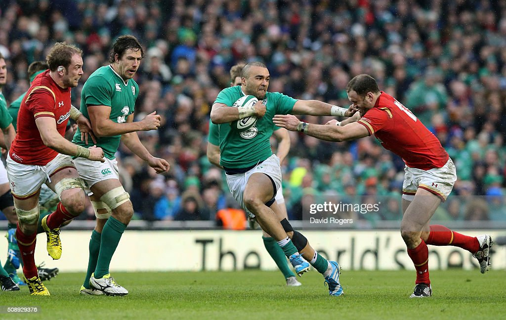 Simon Zebo of Ireland hands of Jamie Roberts of Wales during the RBS Six Nations match between Ireland and Wales at the Aviva Stadium on February 7, 2016 in Dublin, Ireland.