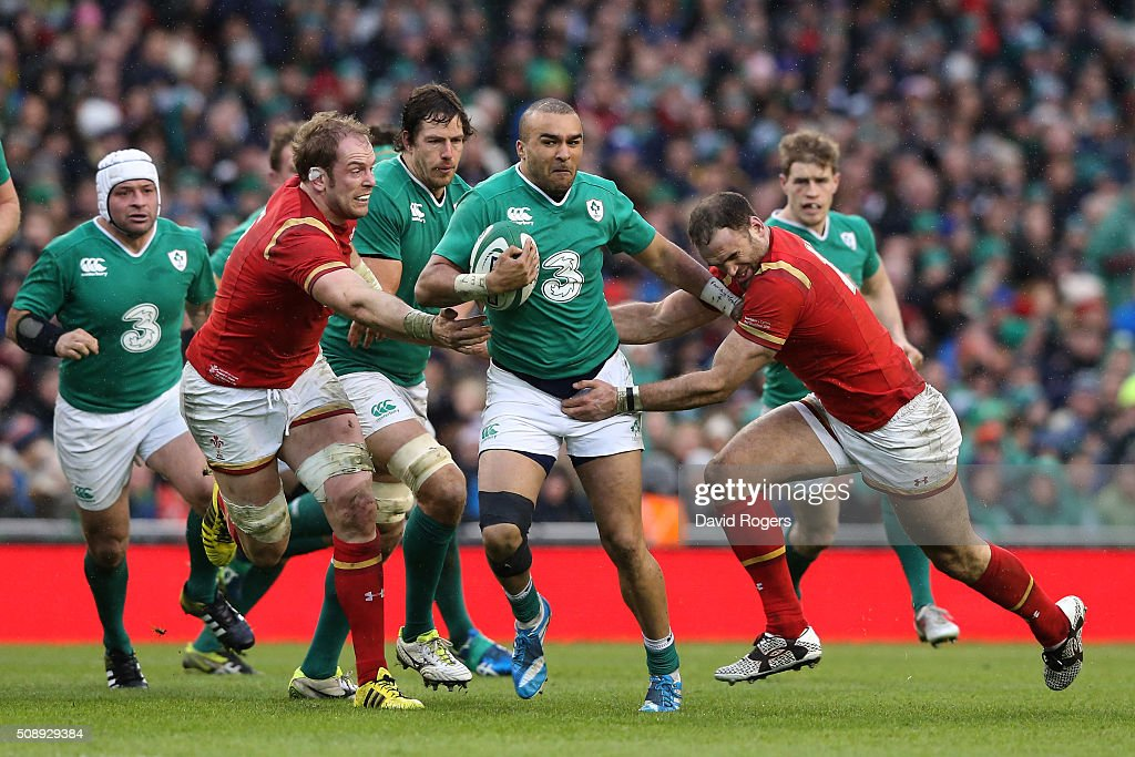 Simon Zebo of Ireland is tackled by Alun Wyn Jones and Jamie Roberts of Wales during the RBS Six Nations match between Ireland and Wales at the Aviva Stadium on February 7, 2016 in Dublin, Ireland.