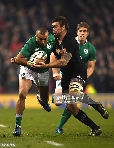 Simon Zebo of Ireland is tackled by Liam Squire of New Zealand during the International match between Ireland and New Zealand All Blacks at Aviva...