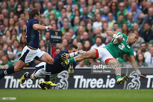 Simon Zebo of Ireland is tackled by Sean Lamont of Scotland during the International match between Ireland and Scotland at the Aviva Stadium on...