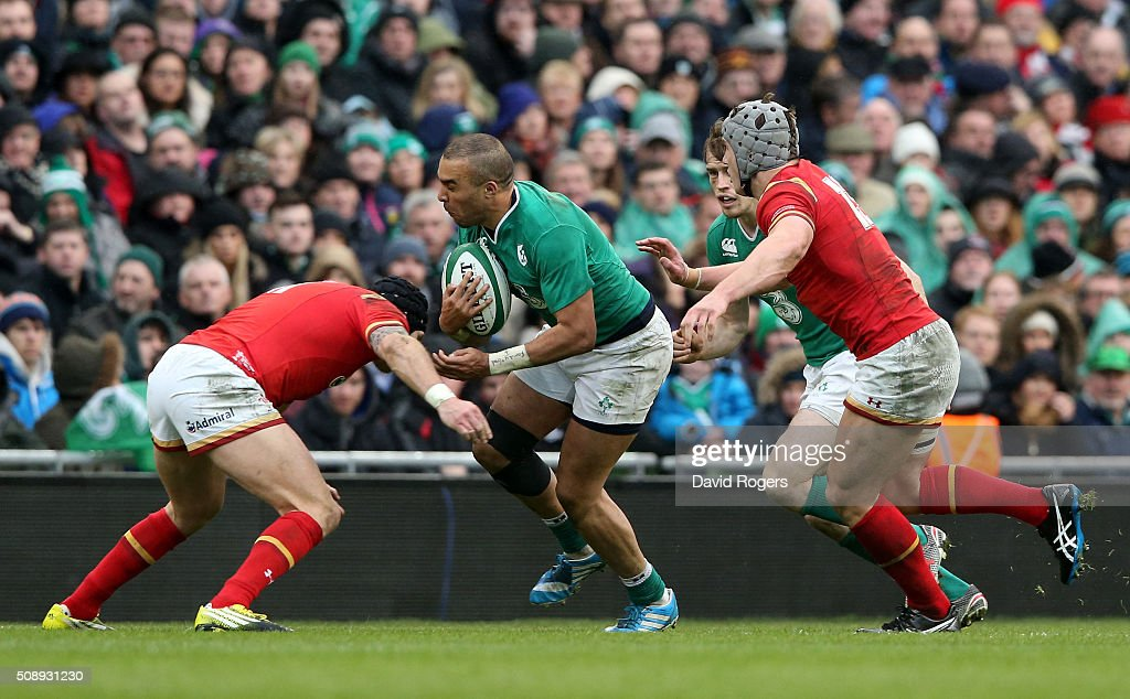 <a gi-track='captionPersonalityLinkClicked' href=/galleries/search?phrase=Simon+Zebo&family=editorial&specificpeople=7036694 ng-click='$event.stopPropagation()'>Simon Zebo</a> of Ireland is tackled by Tom James of Wales and <a gi-track='captionPersonalityLinkClicked' href=/galleries/search?phrase=Jonathan+Davies+-+Rugby+Union+Player+-+Born+1988&family=editorial&specificpeople=8522336 ng-click='$event.stopPropagation()'>Jonathan Davies</a> of Wales during the RBS Six Nations match between Ireland and Wales at the Aviva Stadium on February 7, 2016 in Dublin, Ireland.