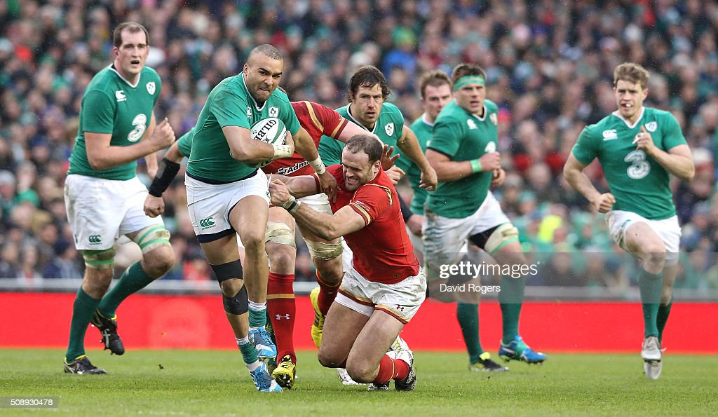 <a gi-track='captionPersonalityLinkClicked' href=/galleries/search?phrase=Simon+Zebo&family=editorial&specificpeople=7036694 ng-click='$event.stopPropagation()'>Simon Zebo</a> of Irleand moves away from <a gi-track='captionPersonalityLinkClicked' href=/galleries/search?phrase=Jamie+Roberts&family=editorial&specificpeople=3530992 ng-click='$event.stopPropagation()'>Jamie Roberts</a> during the RBS Six Nations match between Ireland and Wales at the Aviva Stadium on February 7, 2016 in Dublin, Ireland.