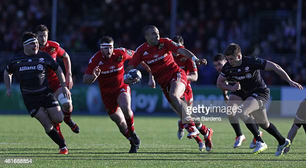 Simon Zebo of Munster breaks away from the Saracens defence during the European Rugby Champions Cup pool one match between Saracens and Munster at...