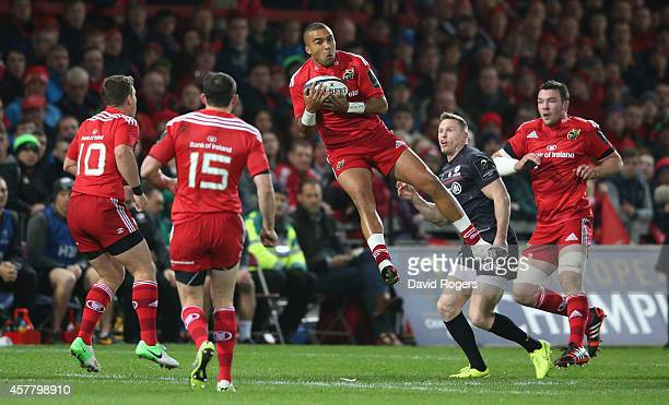 Simon Zebo of Munster catches the ball during the European Rugby Champions Cup match between Munster and Saracens at Thomond Park on October 24 2014...