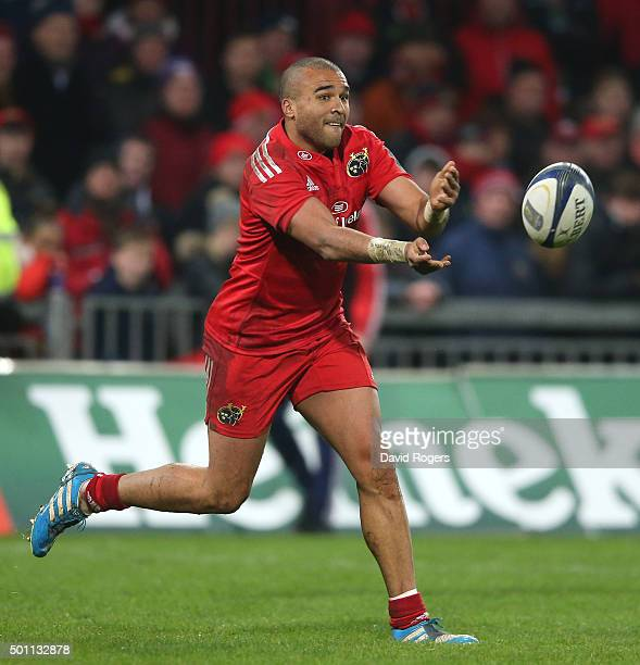 Simon Zebo of Munster passes the ball during the European Rugby Champions Cup match between Munster and Leicester Tigers at Thomond Park on December...