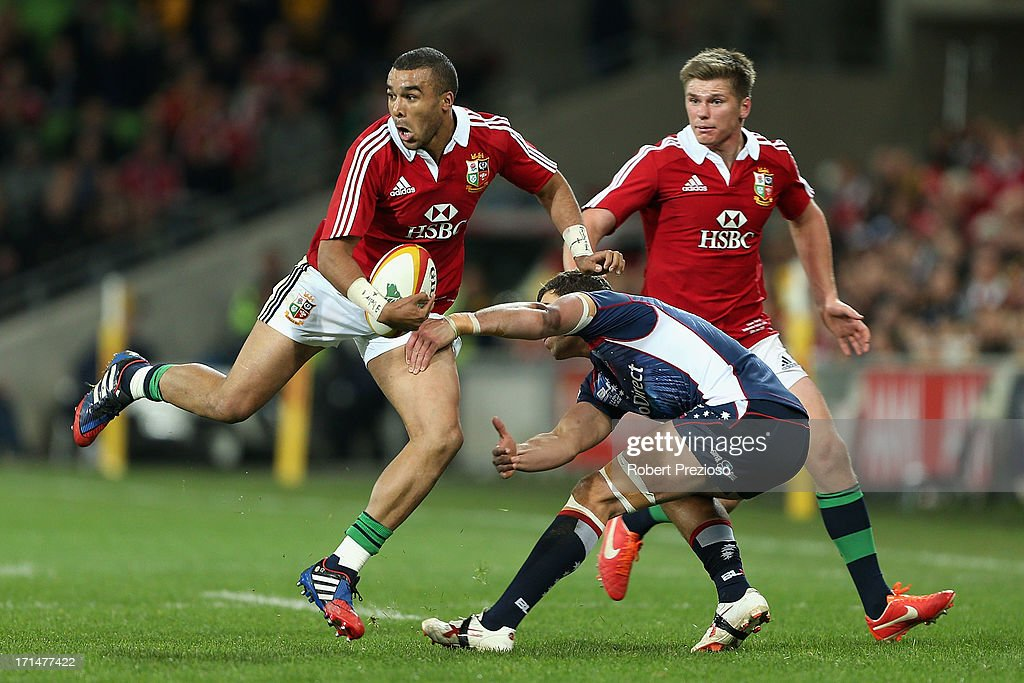 <a gi-track='captionPersonalityLinkClicked' href=/galleries/search?phrase=Simon+Zebo&family=editorial&specificpeople=7036694 ng-click='$event.stopPropagation()'>Simon Zebo</a> of the Lions breaks a tackle during the International Tour Match between the Melbourne Rebels and the British & Irish Lions at AAMI Park on June 25, 2013 in Melbourne, Australia.