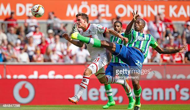 Simon Zoller of Cologne scores the first goal 10 per head against Naldo of Wolfsburg during the Bundesliga match between 1 FC Koeln and VfL Wolfsburg...