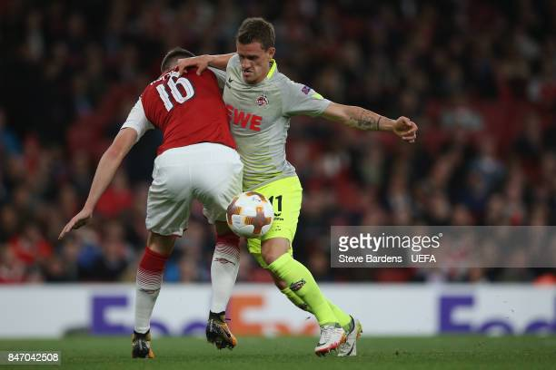 Simon Zoller of FC Koln is tackled by Rob Holding of Arsenal during the UEFA Europa League group H match between Arsenal FC and FC Koln at Emirates...