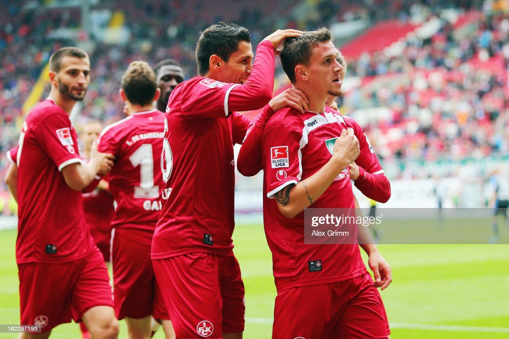 Simon Zoller (R) of Kaiserslautern celebrates his team's second goal with team mate <a gi-track='captionPersonalityLinkClicked' href=/galleries/search?phrase=Karim+Matmour&family=editorial&specificpeople=741965 ng-click='$event.stopPropagation()'>Karim Matmour</a> during the Second Bundesliga match between 1. FC Kaiserslautern and TSV 1860 Muenchen at Fritz-Walter-Stadion on September 29, 2013 in Kaiserslautern, Germany.
