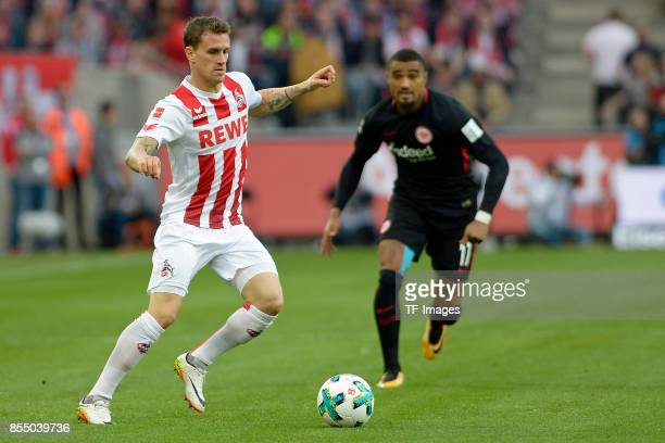 Simon Zoller of Koeln and KevinPrince Boateng of Frankfurt battle for the ball during the Bundesliga match between 1 FC Koeln and Eintracht Frankfurt...