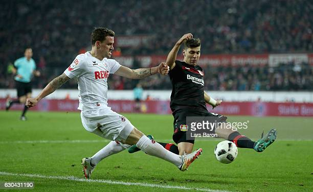 Simon Zoller of Koeln is challenged by Aleksandar Dragovic of Bayer Leverkusen during the Bundesliga match between 1 FC Koeln and Bayer 04 Leverkusen...