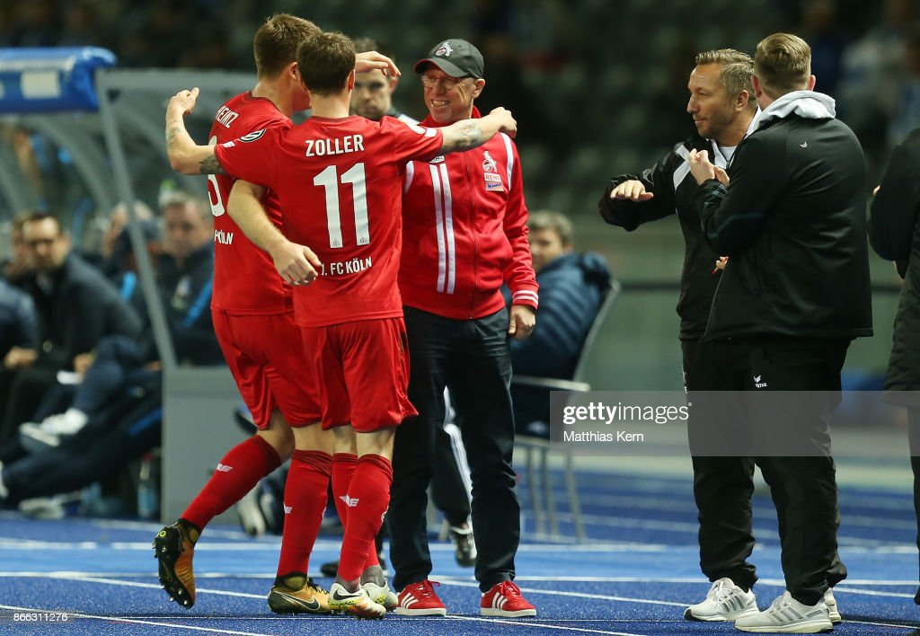 Simon Zoller (C) of Koeln jubilates with team mates and head coach Peter Stoeger (R) after scoring the first goal during the DFB Cup match between Hertha BSC and 1. FC Koeln at Olympiastadion on October 25, 2017 in Berlin, Germany.