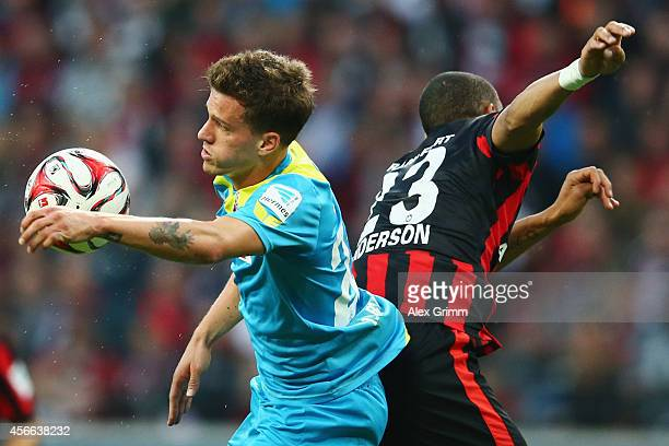 Simon Zoller of Koeln jumps for a header with Bamba Anderson of Frankfurt during the Bundesliga match between Eintracht Frankfurt and 1 FC Koeln at...