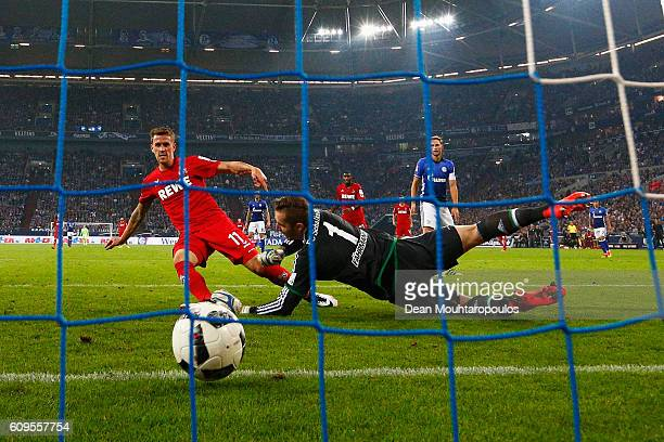 Simon Zoller of Koeln shoots and scores a goal past Goalkeeper Ralf Fahrmann of Schalke during the Bundesliga match between FC Schalke 04 and 1 FC...