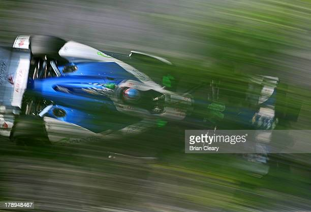 Simona De Silvestro of Switzerland driver of the KV Racing Technology Chevrolet Dallara races under some trees during practice for the Grand Prix of...