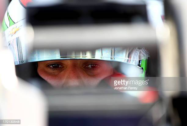 Simona de Silvestro of Switzerland driver of the Nuclear Energy Areva KVRT Chevrolet sits in his car during practice for the IZOD IndyCar Series...