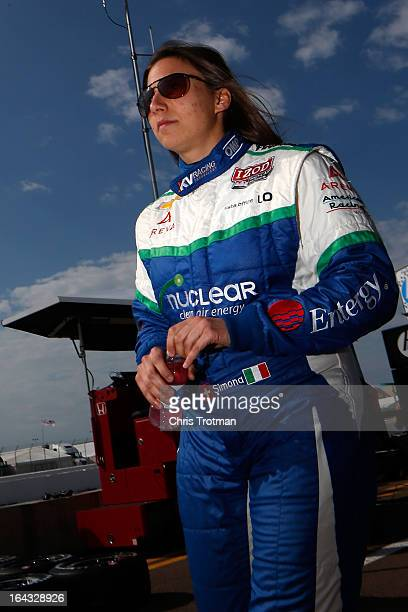 Simona de Silvestro of Switzerland driver of the Nuclear Entergy Areva KVRT Dallara Chevrolet walks on pit lane priot to practice for the IZOD...