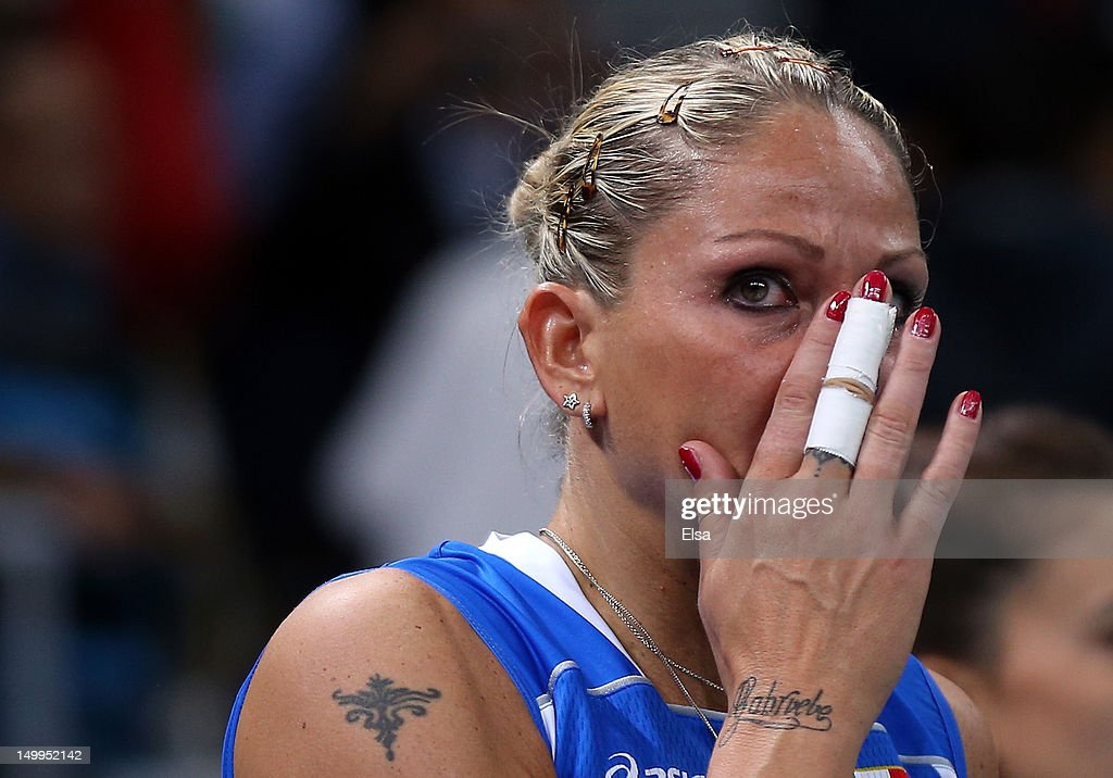 <a gi-track='captionPersonalityLinkClicked' href=/galleries/search?phrase=Simona+Gioli&family=editorial&specificpeople=3032969 ng-click='$event.stopPropagation()'>Simona Gioli</a> #17 of Italy reacts after losing to Korea during Women's Volleyball quarterfinals on Day 11 of the London 2012 Olympic Games at Earls Court on August 7, 2012 in London, England.