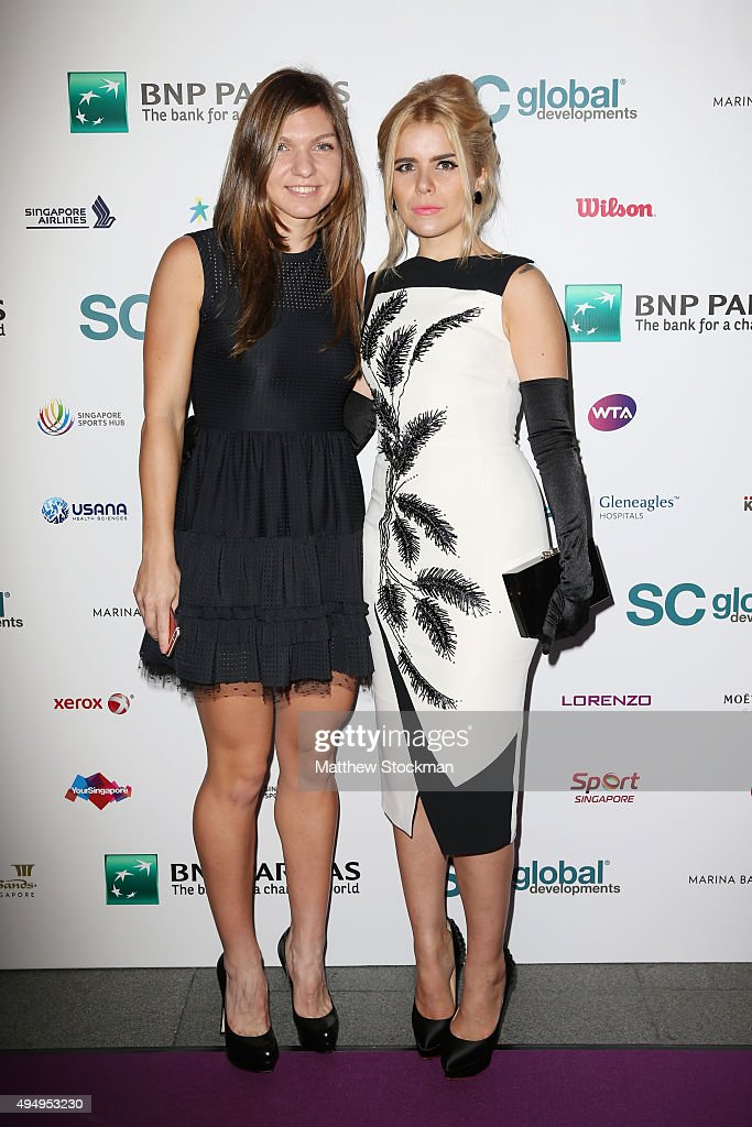 Simona Halep and Paloma Faith attend Singapore Tennis Evening at Marina Bay Sands on October 30, 2015 in Singapore.