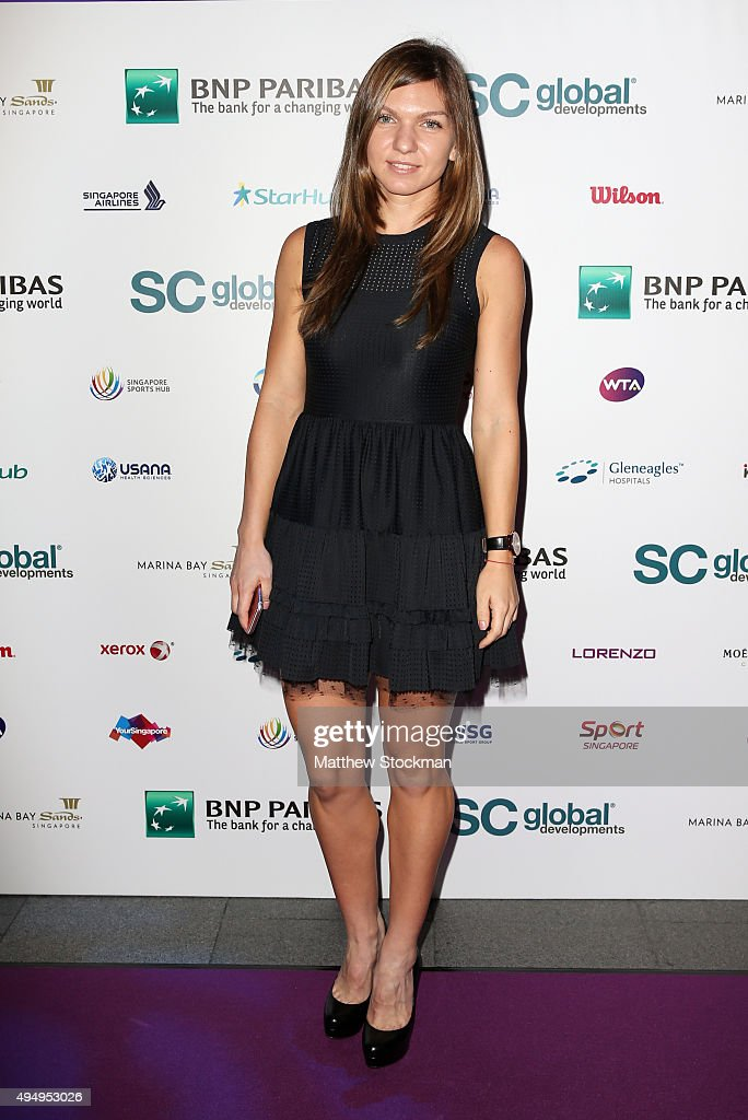 <a gi-track='captionPersonalityLinkClicked' href=/galleries/search?phrase=Simona+Halep&family=editorial&specificpeople=4835837 ng-click='$event.stopPropagation()'>Simona Halep</a> attends Singapore Tennis Evening at Marina Bay Sands on October 30, 2015 in Singapore.