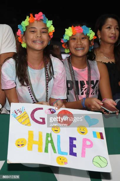 Simona Halep fans celebrate after her victory in the singles match against Caroline Garcia of France during day 2 of the BNP Paribas WTA Finals...