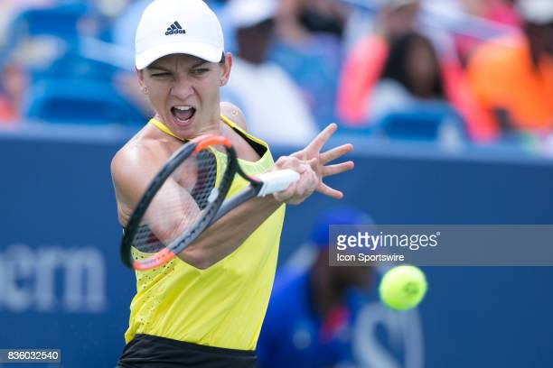 Simona Halep hits a forehand during the championship match against Garbine Muguruza and Simona Halep at the Western Southern Open at the Lindner...
