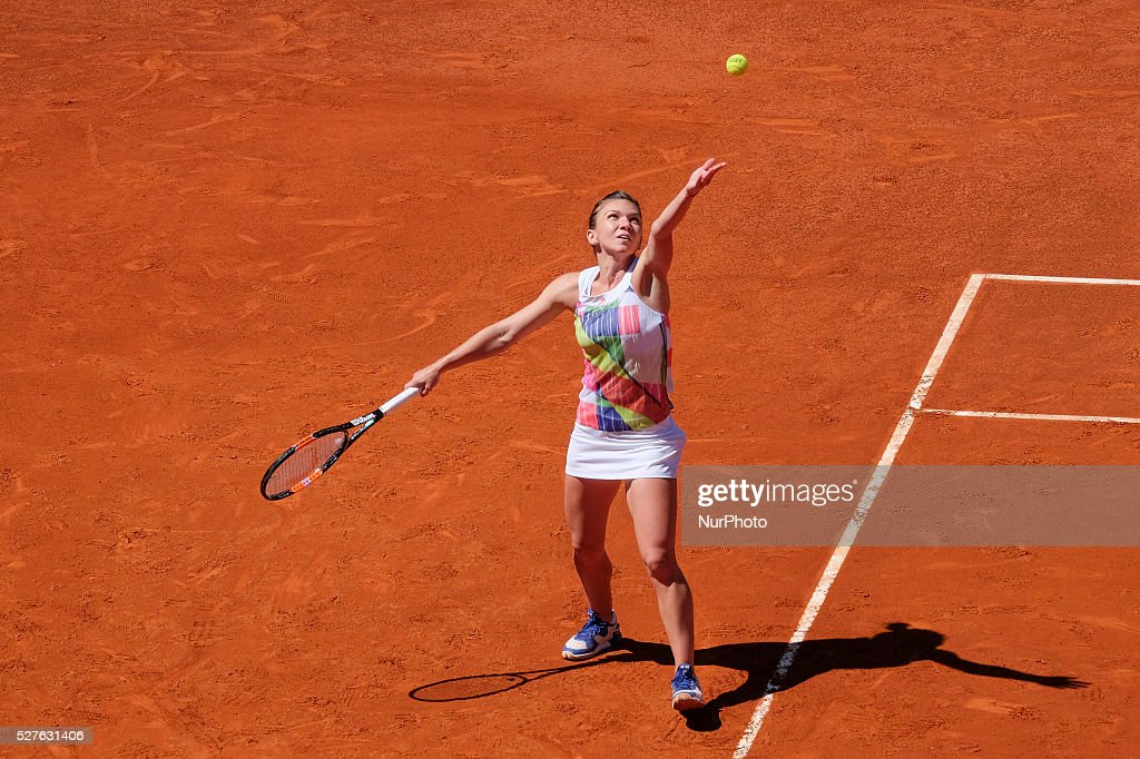 <a gi-track='captionPersonalityLinkClicked' href=/galleries/search?phrase=Simona+Halep&family=editorial&specificpeople=4835837 ng-click='$event.stopPropagation()'>Simona Halep</a> in action their match during day fourth of the Mutua Madrid Open tennis tournament at the Caja Magica on May 03 2016 in Madrid,Spain.