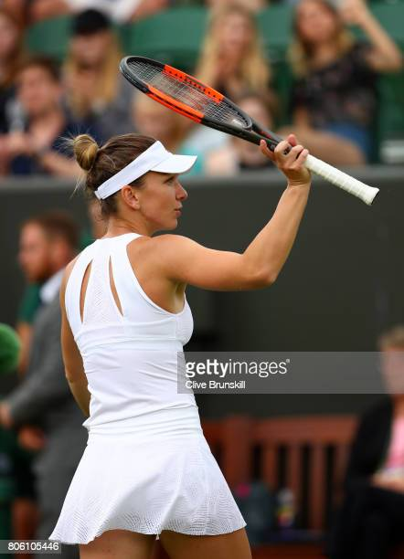Simona Halep of Romania acknowledges the crowd in victory after the during the Ladies Singles first round match against Marina Erakovic of New...
