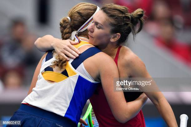 Simona Halep of Romania and Jelena Ostapenko of Latvia greet each other after their WomenÕs single semifinal match on day eight of the 2017 China...