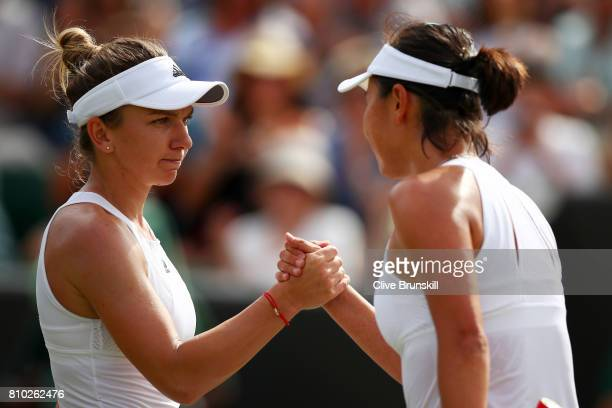 Simona Halep of Romania and Shuai Peng of China shake hands after the Ladies Singles third round match on day five of the Wimbledon Lawn Tennis...