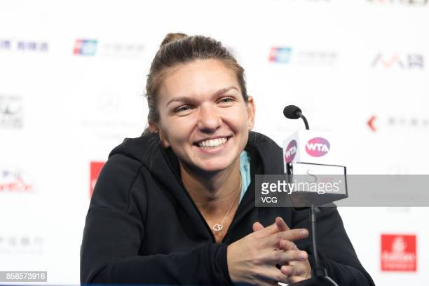 Simona Halep of Romania attends the press conference after winning the Women's singles semifinals match against Jelena Ostapenko of Latvia on day...