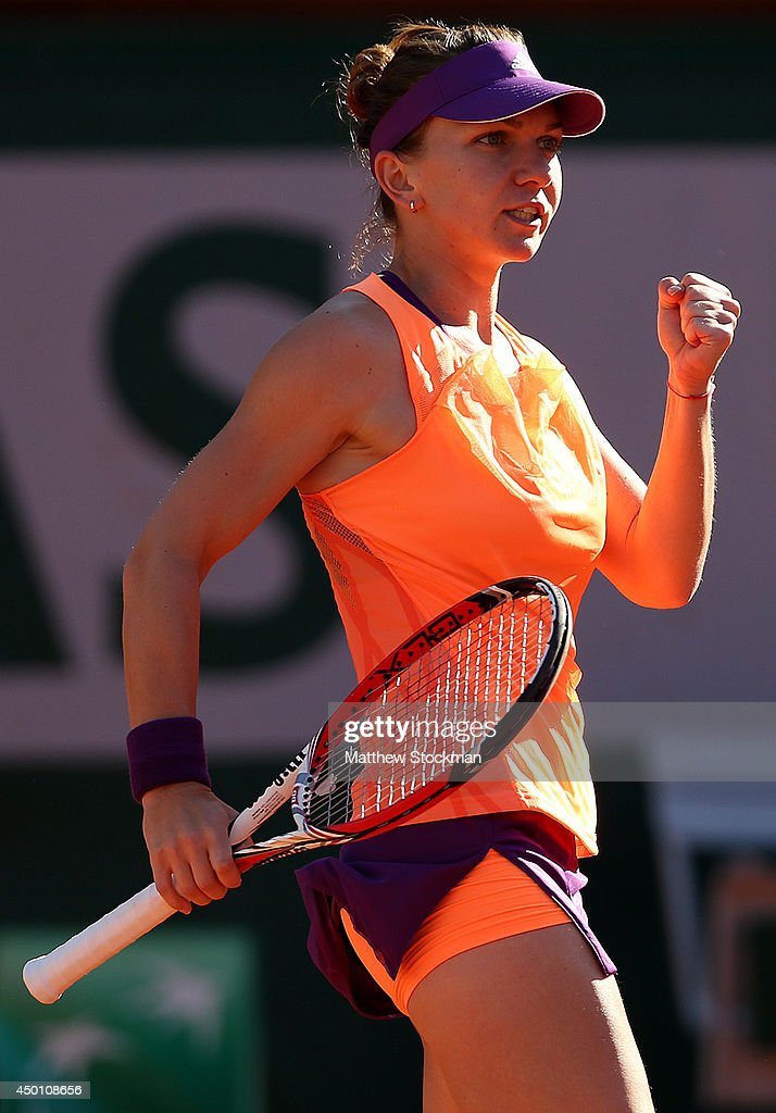 Simona Halep of Romania celebrates a point during her women's singles match against Andrea Petkovic of Germany on day twelve of the French Open at...