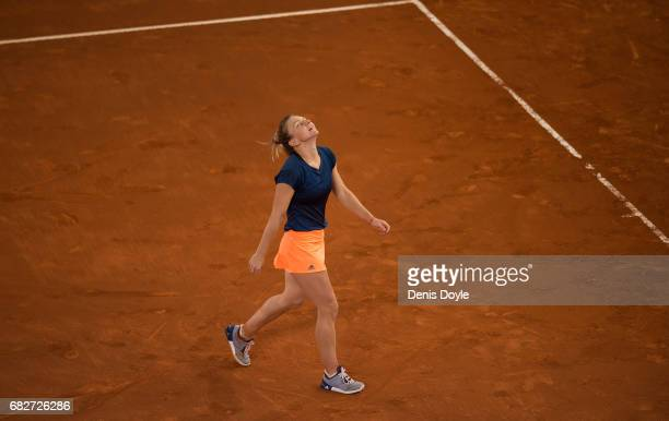 Simona Halep of Romania celebrates after beating Kristina Mladenovic of France in their final match during day eight of the Mutua Madrid Open tennis...