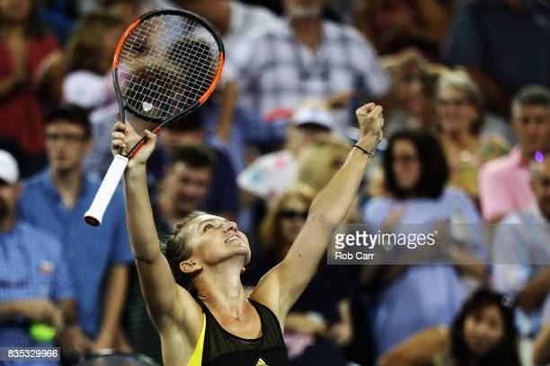 Simona Halep of Romania celebrates after defeating Johanna Konta of Great Britain during Day 7 of the Western and Southern Open at the Linder Family...