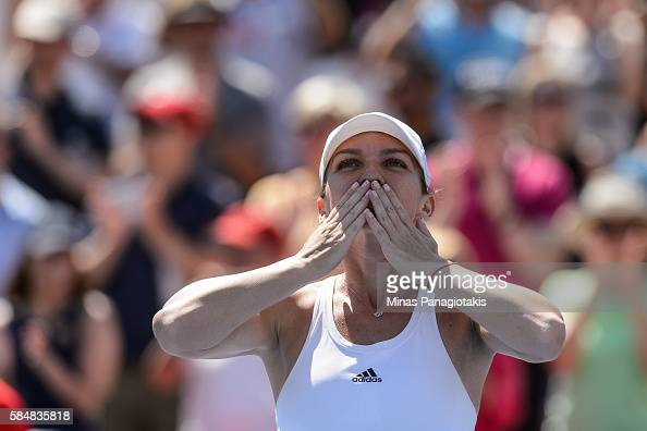 Simona Halep of Romania celebrates after defeating Madison Keys of the United States during day seven in final round action of the Rogers Cup at...