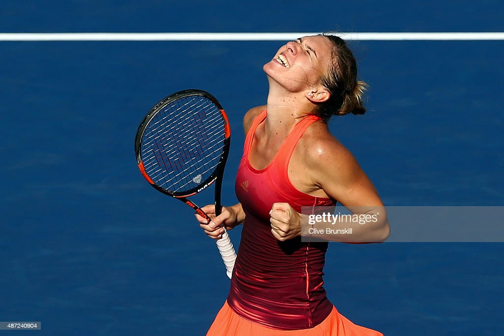 Simona Halep of Romania celebrates after defeating Sabine Lisicki of Germany during their Women's Singles Fourth Round match on Day Eight of the 2015...