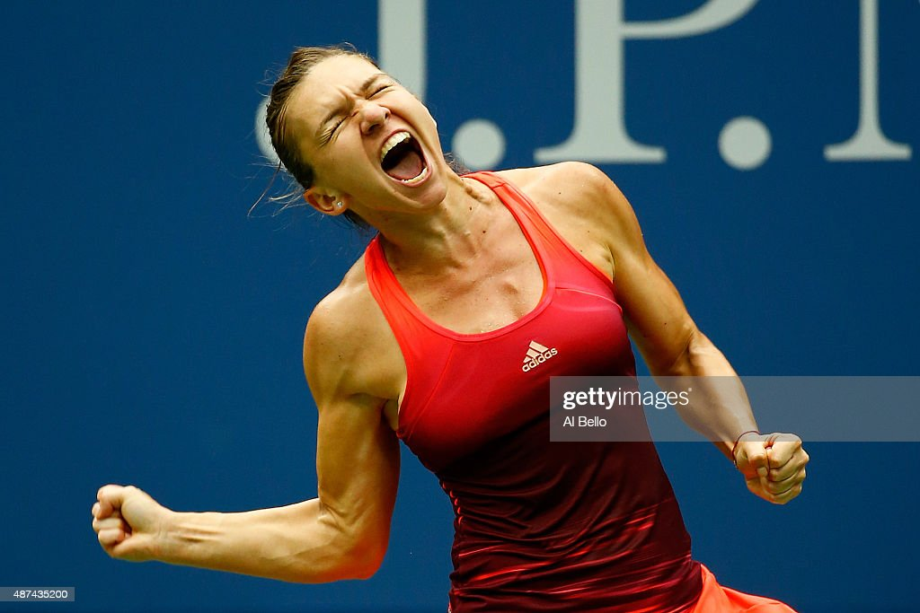 <a gi-track='captionPersonalityLinkClicked' href=/galleries/search?phrase=Simona+Halep&family=editorial&specificpeople=4835837 ng-click='$event.stopPropagation()'>Simona Halep</a> of Romania celebrates after defeating Victoria Azarenka of Belarus during their Women's Singles Quarterfinals match on Day Ten of the 2015 US Open at the USTA Billie Jean King National Tennis Center on September 9, 2015 in the Flushing neighborhood of the Queens borough of New York City.
