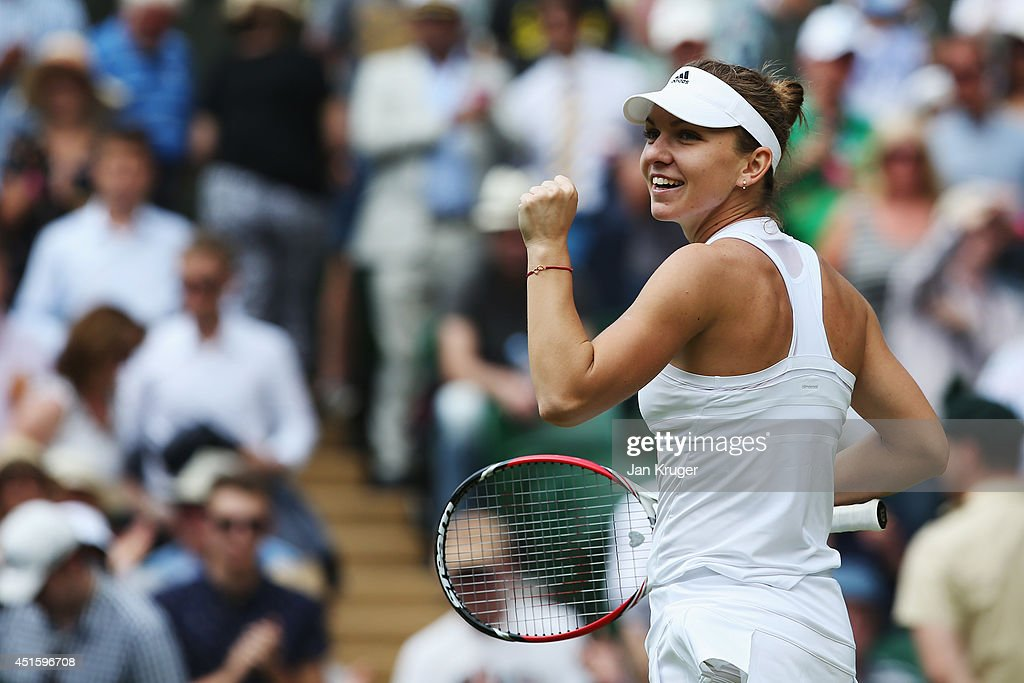 <a gi-track='captionPersonalityLinkClicked' href=/galleries/search?phrase=Simona+Halep&family=editorial&specificpeople=4835837 ng-click='$event.stopPropagation()'>Simona Halep</a> of Romania celebrates after winning her Ladies' Singles quarter-final match against Sabine Lisicki of Germany on day nine of the Wimbledon Lawn Tennis Championships at the All England Lawn Tennis and Croquet Club at Wimbledon on July 2, 2014 in London, England.