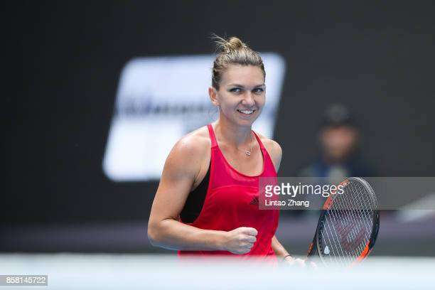 Simona Halep of Romania celebrates after winning the Women's singles Quarterfinals match against Daria Kasatkina of Russia on day seven of 2017 China...