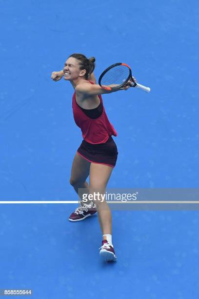 Simona Halep of Romania celebrates after winning the Women's Singles Semifinals match against Jelena Ostapenko of Latvia on day eight of 2017 China...